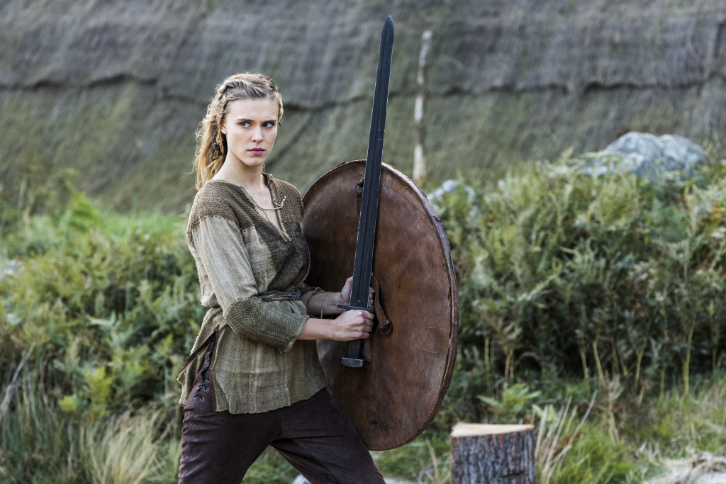 Porunn (Gaia Weiss) looking a bit like a young Lagertha with those blonde braids, beautiful looks, bearing a shield & sword!